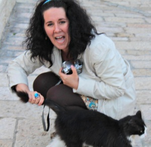 Amy in Jerusalem, Israel  in spring of 2011 making a new furry friend. Photo by: Heather Hollands