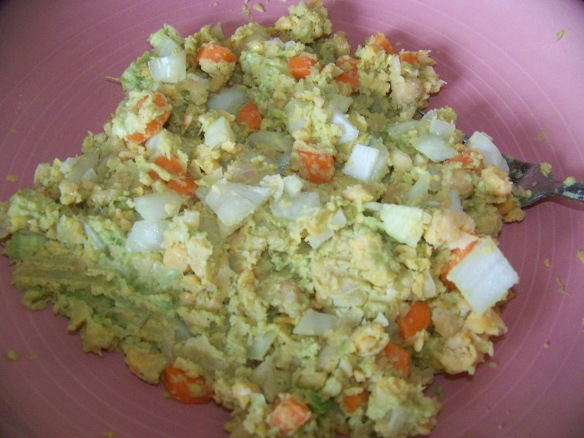 Fold in the onion and carrot to the bean and avocado mixture.