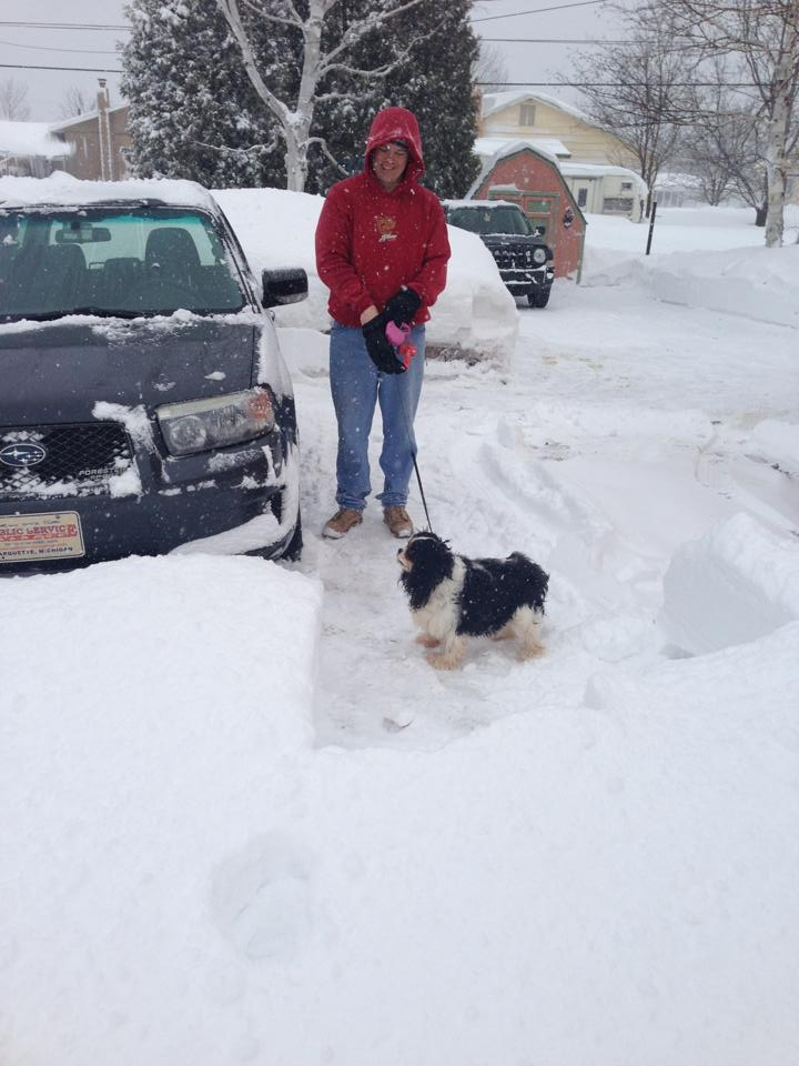 Mike takes a break from snow plowing with his best friend, Phoebe. He just finished telling me that if I had a Subaru (like he does) instead of a Jeep that there would be no need for snow blowing our drive. ;)