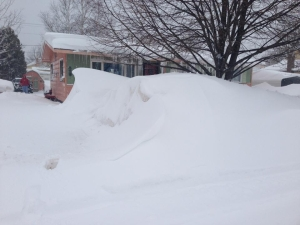 Our poor little house engulfed in snow banks
