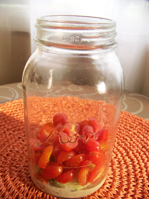I find that cherry or grape tomatoes hold their shape better and do not get as runny in the jars as larger tomatoes.