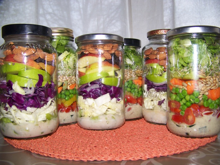 The end of the school year is racing at me. I find that prepping my lunches and dinners makes healthy eating a snap. If you find yourself in a pinch at mealtime you cannot go wrong with salads in a jar.