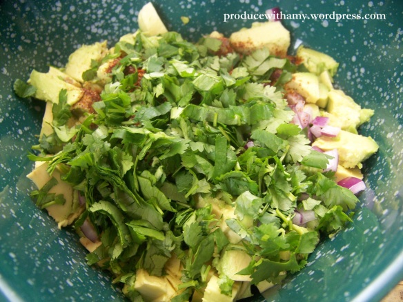 Fresh cilantro really perks up the flavor of the avocado. Add the garlic and lime juice as well.