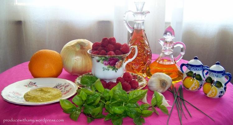 Raspberry Basil Vinaigrette: Dijon Mustard, Orange Juice, Onion, Raspberries, Basil, White Balsamic Vinegar, Extra Virgin Olive Oil, Chives, and Salt & Pepper.