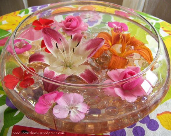 I love to take flowers and blossoms from my garden and float them in vases and bowls (with or without candles).