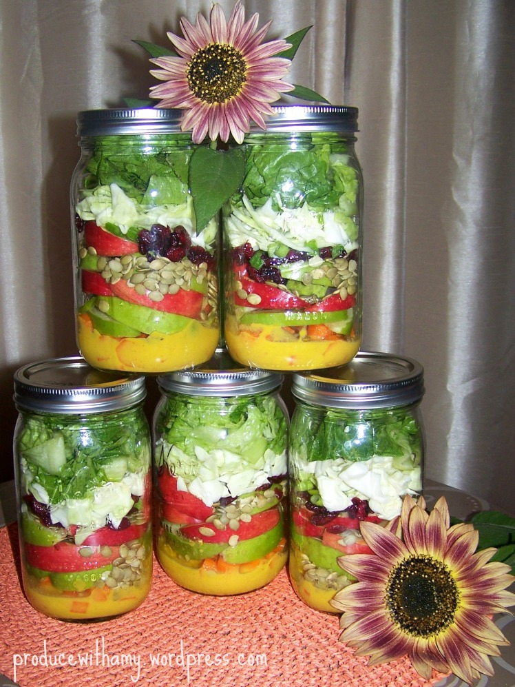 Sweet and Savory ingredients make these Apple-a-Day Mason Jar Salads with Pumpkin Vinaigrette Dressing a seasonal hit!