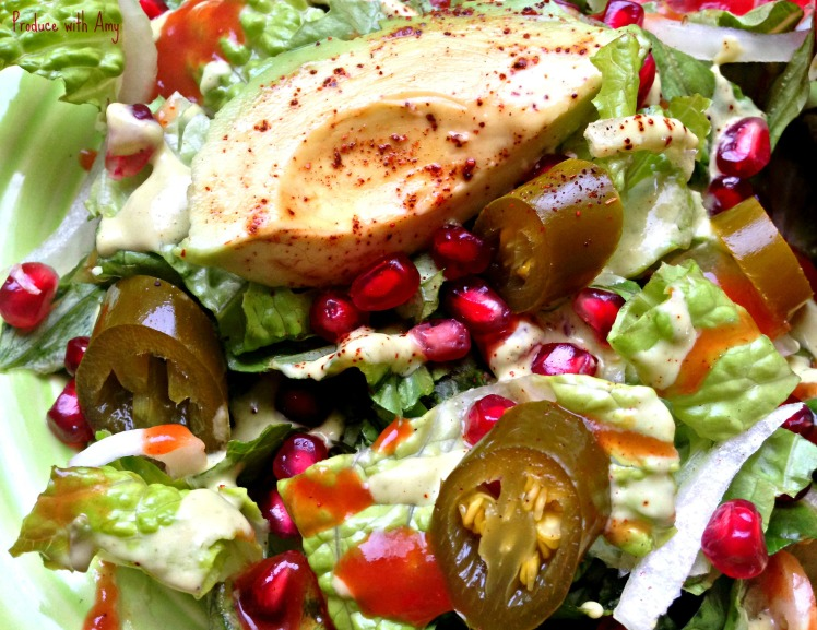 Salad with pomegranate, avocado, and pickled jalapenos