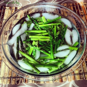 Blanching involves a quick immersion in boiling water and placing the vegetable instantly in an ice bath. This process allows the asparagus to turn vibrant green and remain crisp.