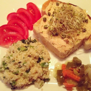 Homemade bread toasted and spread with sun-dried hummus and topped with broccoli sprouts and capers. A side of quinoa tabbouleh, tomatoes, and Chicago style hot peppers.