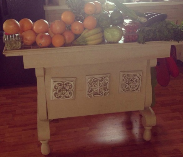 A sampling of yesterday's produce on the kitchen island and my husband upcycled from an old table.
