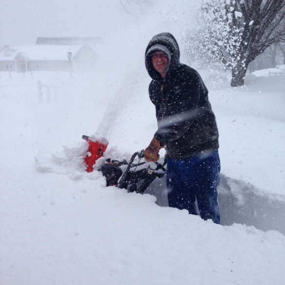 Mike - still smiling even though the snow is reaching beyond the snow blower.