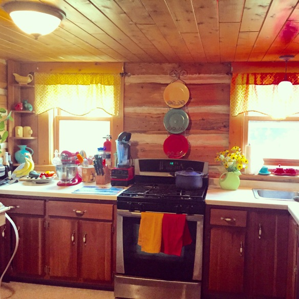 We have been working on quite a few projects around the house. My job has been to add some feminine touches to John's masculine cabin. Thankfully he loves the look of bright colors and my Fiestaware collection. He agreed that the cabin needed a feminine touch.
