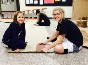 Avalon and Kori decorating the hallway for Homecoming.