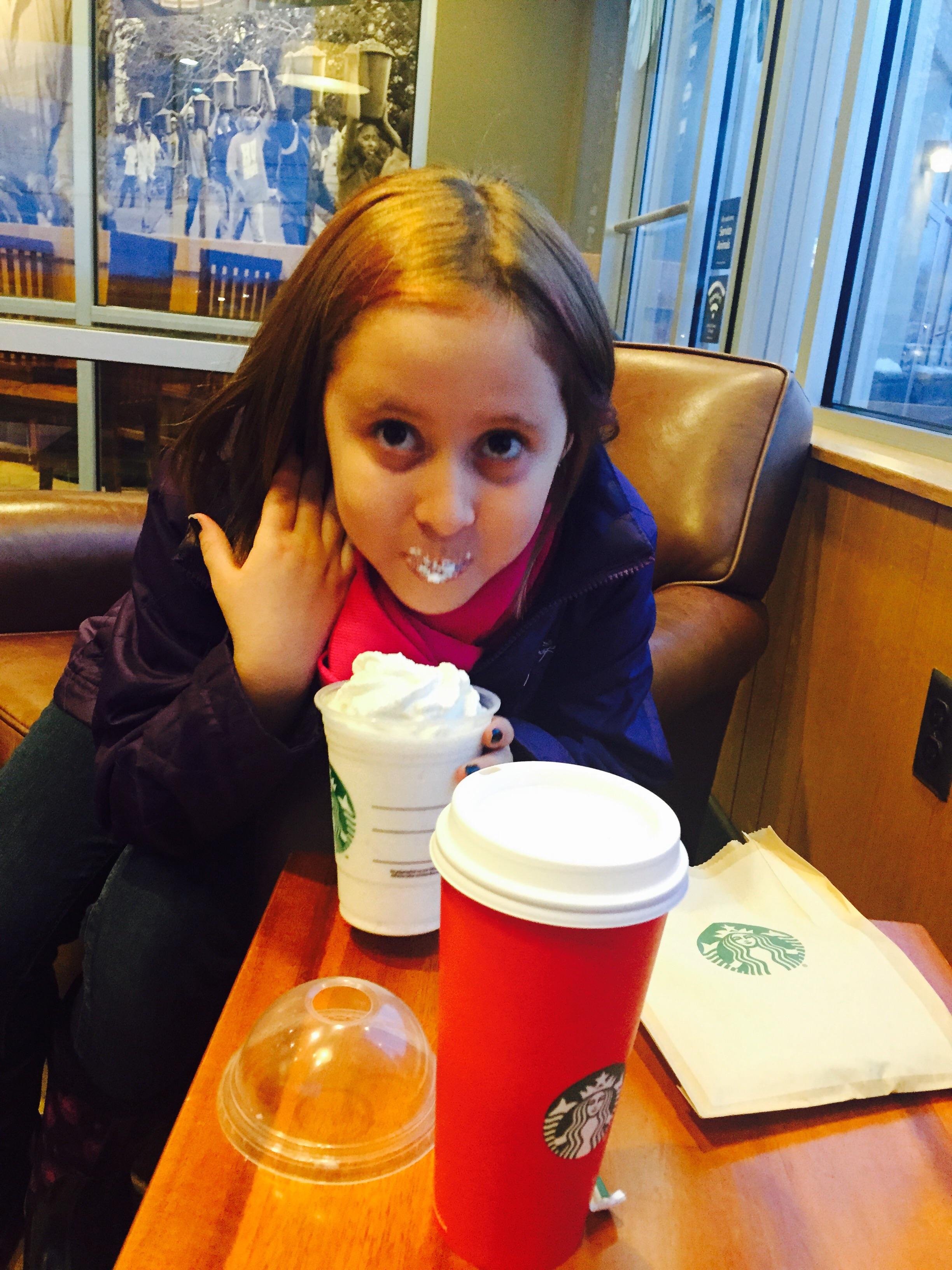 Miss Avalon enjoying her Starbucks treat.