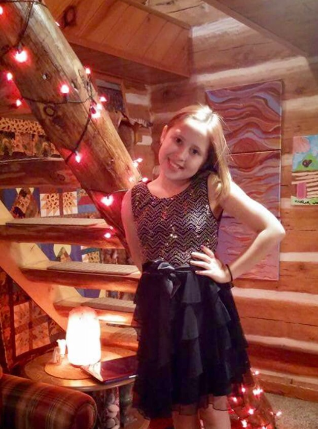 Avalon posing in her Homecoming dress. What a beauty!