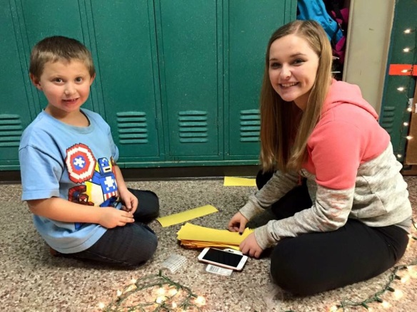 Lukas and Lorraine work on creating the yellow brick road in the hallway.