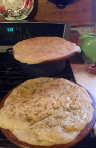 Pizza dough right out of the oven. After I removed it, I spread one with the infused olive oil and the other with pizza sauce.