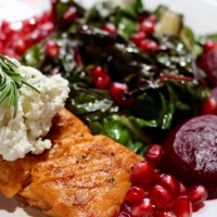 SAUTEED SWISS CHARD WITH SMOKED SALMON, POMEGRANATE, & ROSEMARY INFUSED GOAT CHEESE